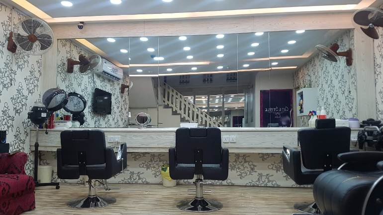 Root Touching + Hair Cut + Skin Polisher + Eyebrows Threading by Cut & Style Ladies Salon, Commercial Area, Phase 1, DHA, Lahore