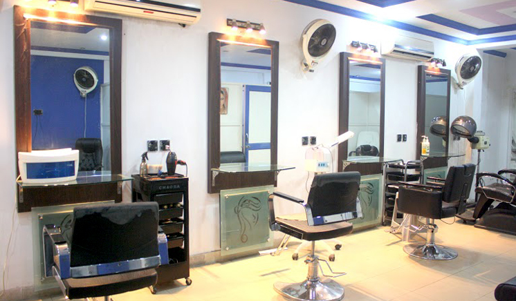 Double Action Fruit Whitening Facial OR Double Whitening Facial + Skin Glowing Herbal Face Polisher + Deluxe Whitening Manicure and Pedicure + Hair Cut OR Hair Protein Treatment + Hand & Feet Massage + Royal Head, Neck & Shoulder Massage + Threading (Eyebrows & Upper Lips) at Blue Scissor Salon & Studio Wapda Town Lahore.