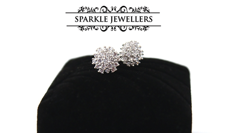 A Pair of 925 Sterling Silver Diamond Cut Studs by Sparkle Jewellers