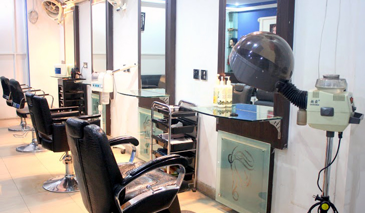 Party Makeup & Hairstyle + Blow Dry OR Hair Straightning + Nail Polishing + Nail Color Application at Blue Scissor Salon & Studio (Wapda Town & Johar Town) Lahore.