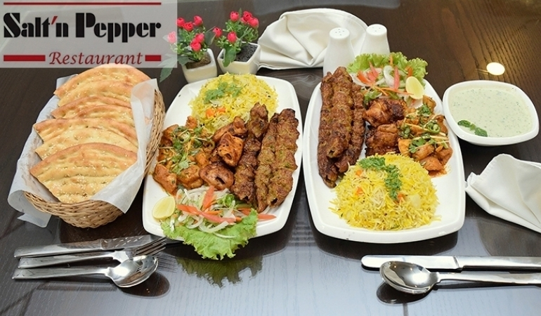 Pakistani VIP Meal For 2 Get Boneless Chicken Handi + 4 Boneless Chicken Boti + 4 pcs Chicken Seekh Kabab + Vegetable Biryani + 1 Mint Raita & Kachumar Salad +2 Nan +2 Deserts From Saltn Pepper